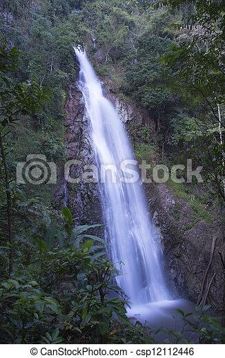 Una larga cascada en la montaña - csp12112446