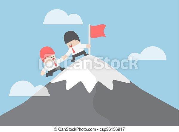El empresario ayuda a su amigo a llegar a la cima de la montaña - csp36156917