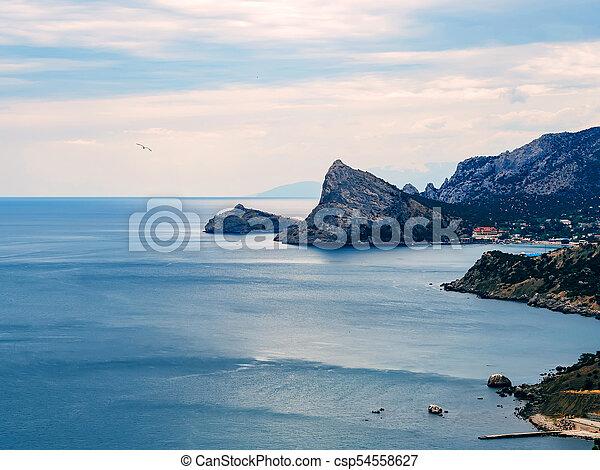 Paisaje azul con mar y montañas - csp54558627