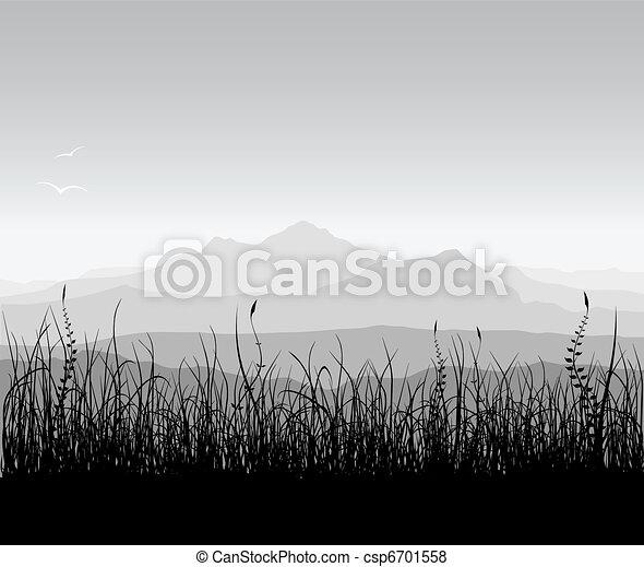 Paisaje con hierba y montañas - csp6701558