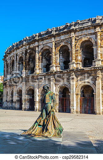 Monument to bullfighter in front of amphitheater - csp29582314
