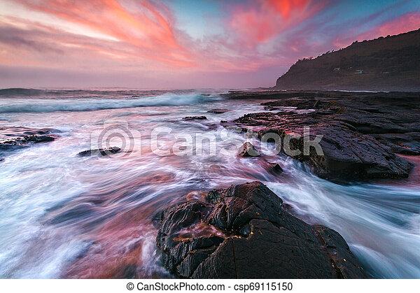 Moody coastal waves and epic sky of Garie Beach - csp69115150