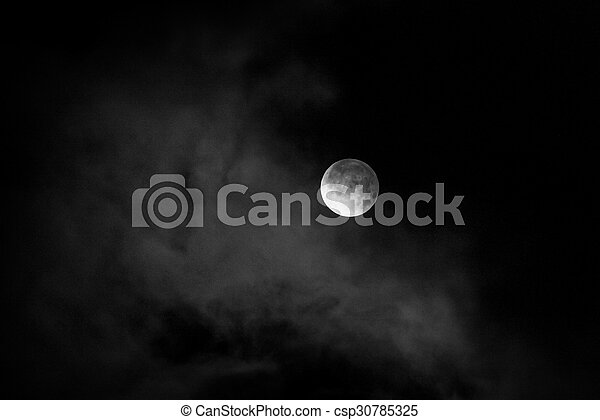 moon in night skies covered by the cloud. Monochrome - csp30785325