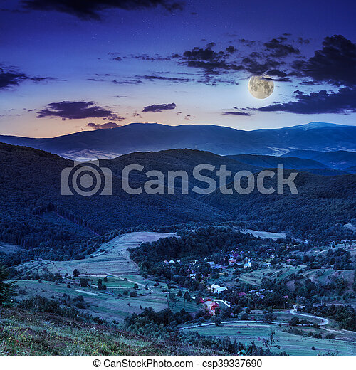 moon light falls on hillside with autumn forest in mountain - csp39337690