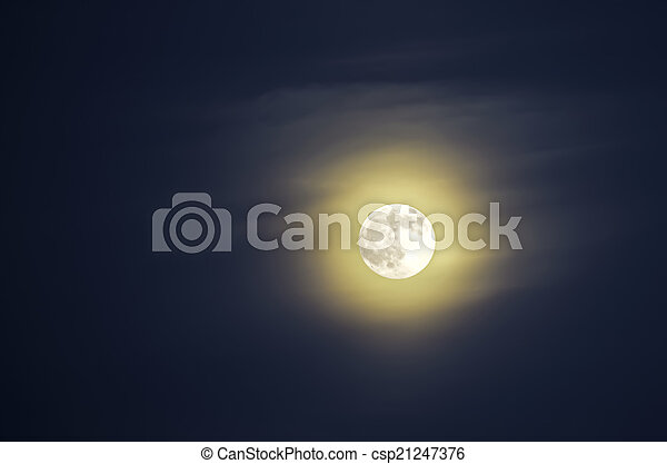 Moon on the background of blue sky - csp21247376