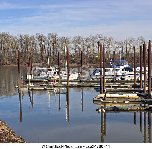 Moored motorboats in a small marina Oregon. - csp24780744