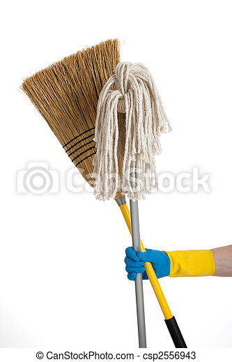 Mop and broom being held by a rubber gloved hand - csp2556943