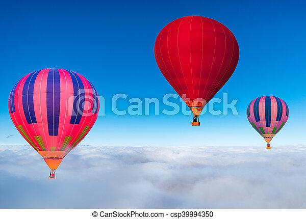 Morning flight of the three hot air balloons. - csp39994350