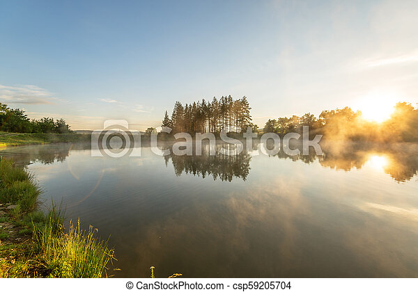 Morning fog on the forest lake. - csp59205704