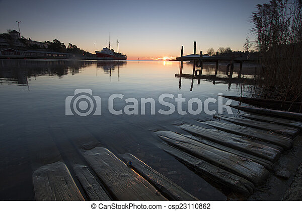 Morning light in the harbour-1 - csp23110862