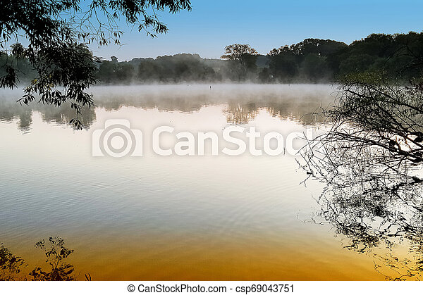 Morning mist over the lake - csp69043751