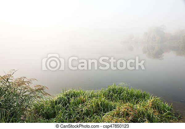 Morning mist over the lake with reflection in the water. Fog on a river - csp47850123
