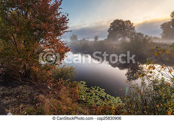 Morning on the bank of autumn lake - csp25830906