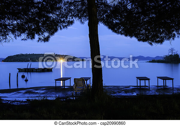 Morning on the shore of a mountain lake - csp20990860