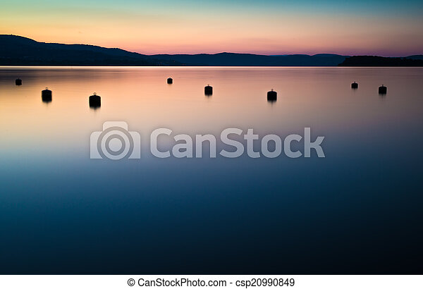 Morning on the shore of a mountain lake - csp20990849