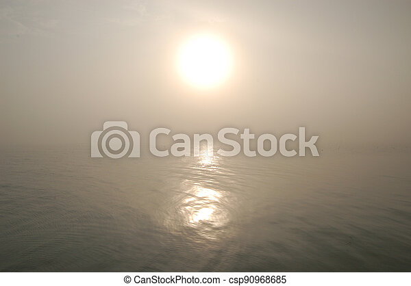 Morning Sun in the Erie Fog - csp90968685