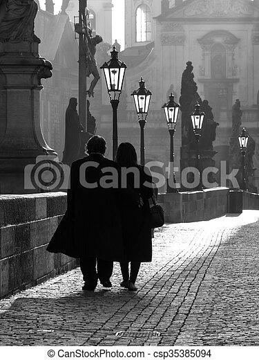 Morning walk on Charles Bridge in Prague - csp35385094