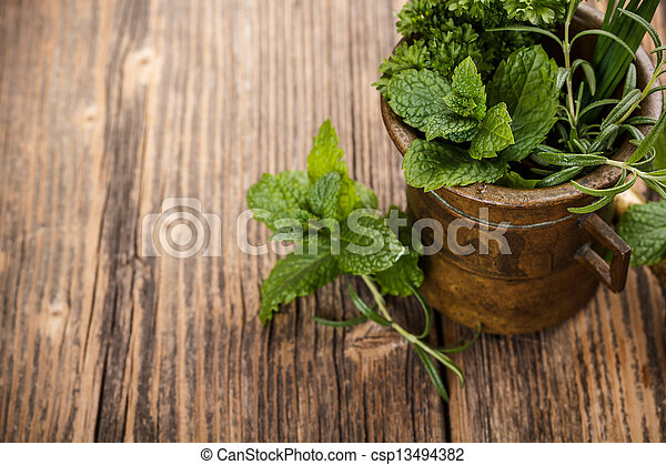 Mortar with herbs - csp13494382