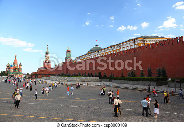 MOSCOW-JUNE 21: Tourists on Red Sguare near Kremlin wall, June 21, 2010 in Moscow, Russia. The sguare itself is around 330 meters (1100 ft) long and 70 meters (230 ft) wide. - csp8000109