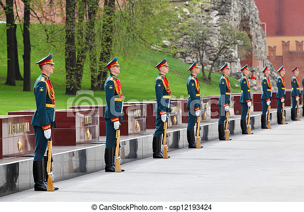 MOSCOW - MAY 8: Row of soldiers at laying of wreaths at tomb of Unknown Soldier at Victory Day on Red Square, on May 8, 2011, Moscow, Russia. - csp12193424