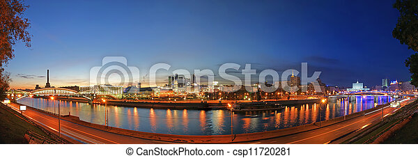 Moscow, Russia. Night. Panoramic view from the embankment of the Moskva River in the Kievsky train station, international business centre and bridges - csp11720281