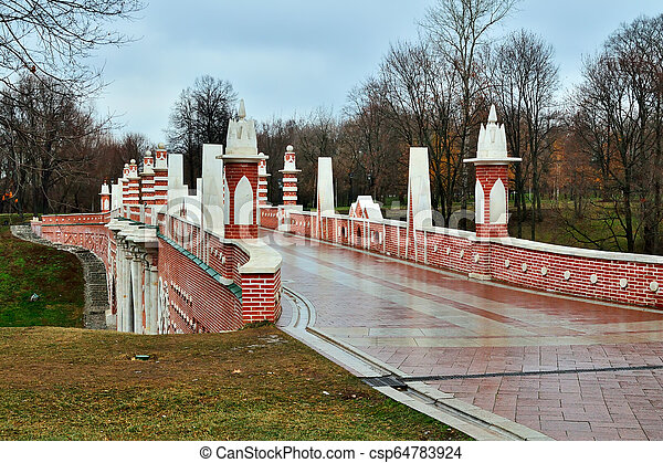 Moscow, Russia, Tsaritsyno - November 19, 2018: Great bridge over the ravine, Gothic bridge. Palace and Park ensemble in the South of Moscow - csp64783924