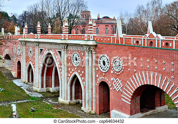 Moscow, Russia, Tsaritsyno - November 19, 2018: Great bridge over the ravine (Gothic bridge). Palace and Park ensemble in the South of Moscow - csp64634432