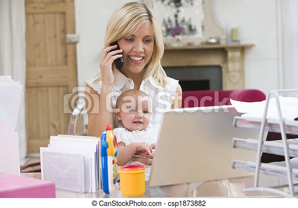Mother and baby in home office with laptop and telephone - csp1873882