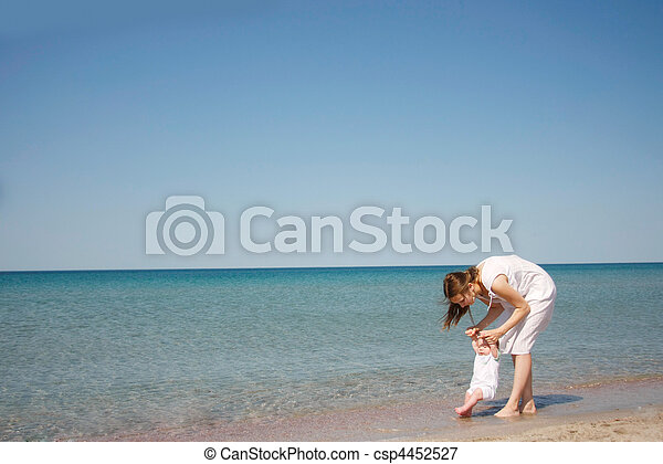mother and baby on beach - csp4452527