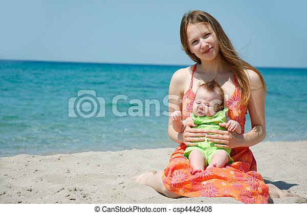mother and baby on beach - csp4442408