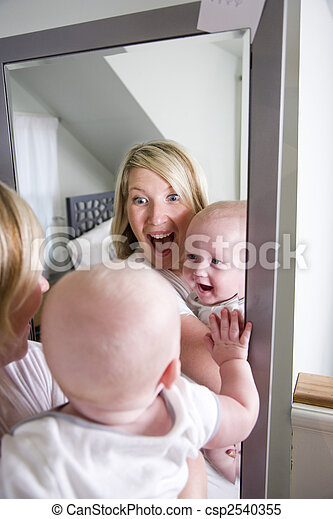 Mother and baby playing in mirror - csp2540355
