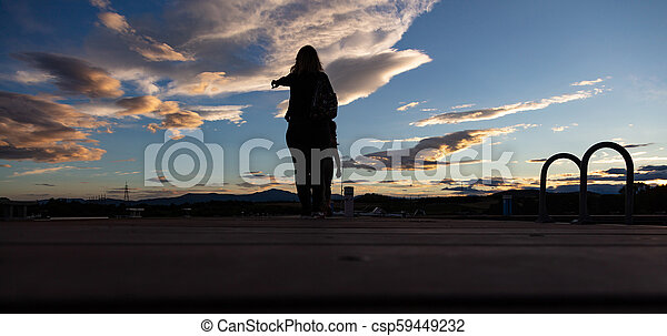 Mother and child and at sunset over mountain range, white clouds, banner, wallpaper. - csp59449232