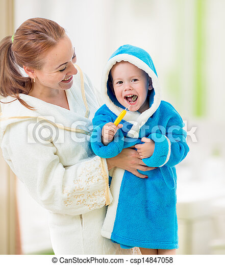 mother and child brushing teeth together in bathroom. Dental hygiene. - csp14847058