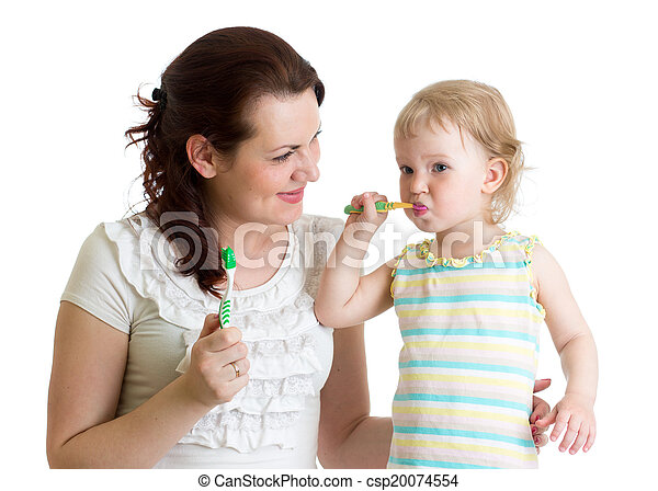 mother and child daughter brushing teeth in bathroom - csp20074554
