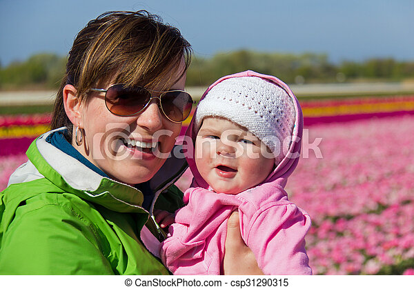 Mother and child happy at flower farm - csp31290315