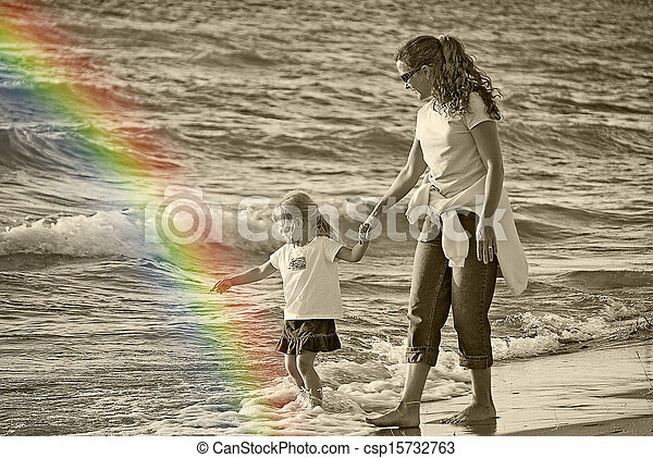 mother and child on a beach - csp15732763