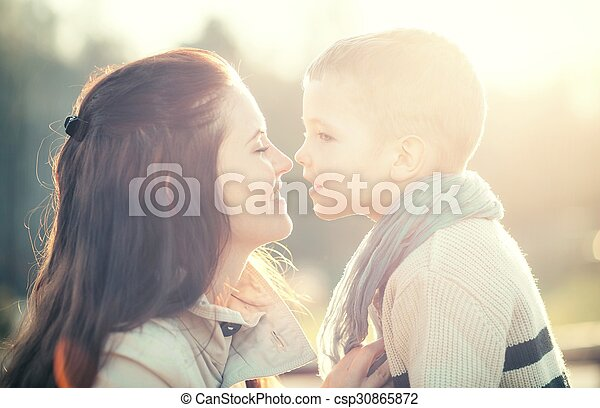 Mother and child playing in the park - csp30865872