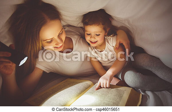 Family reading bedtime mom and child reading book with a stock mother and child read book under blanket with a flashlight sciox Gallery