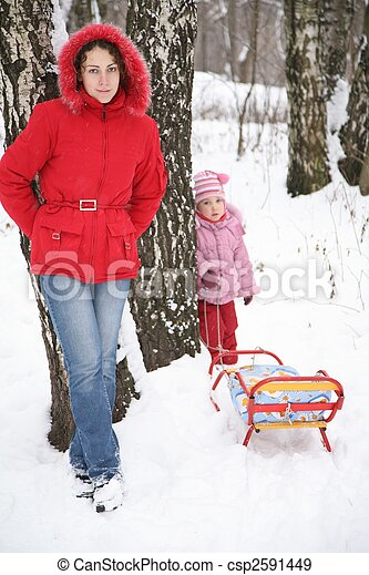 mother and child stand in park at winter - csp2591449