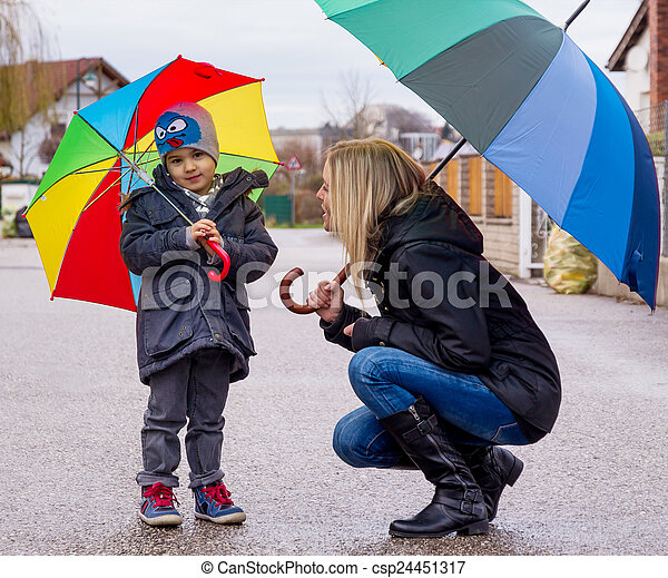 mother and child with umbrella - csp24451317