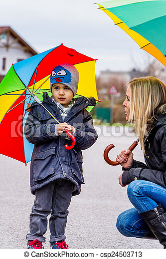 mother and child with umbrella - csp24503713
