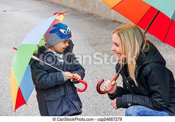 mother and child with umbrella - csp24687279