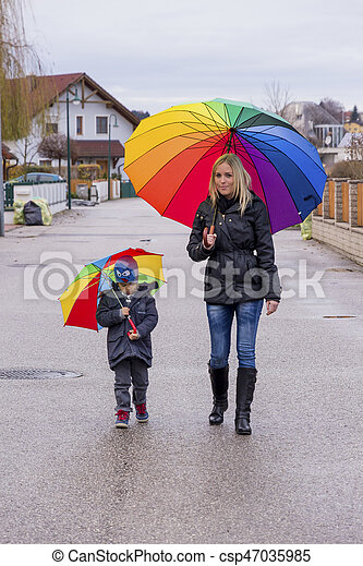 mother and child with umbrella - csp47035985