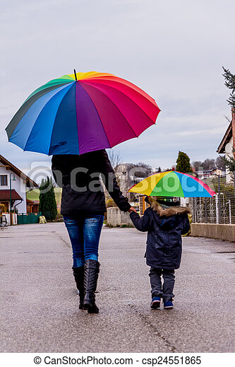 mother and child with umbrella - csp24551865