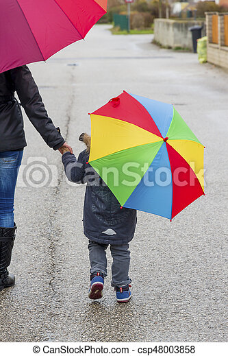 mother and child with umbrella - csp48003858