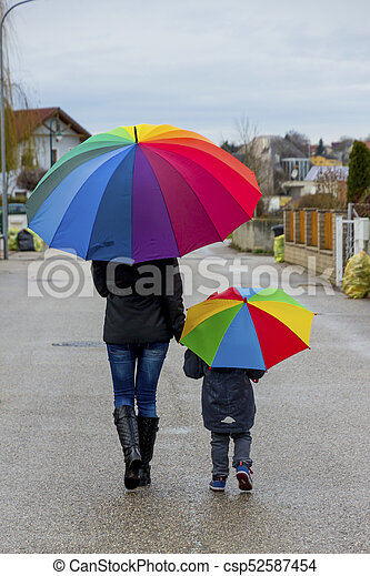 mother and child with umbrella - csp52587454