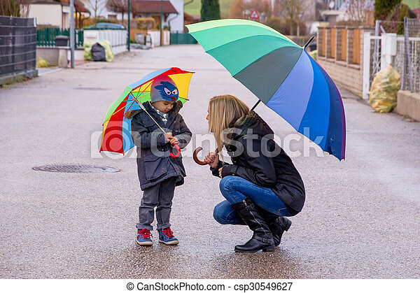 mother and child with umbrella - csp30549627
