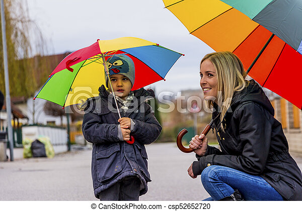 mother and child with umbrella - csp52652720