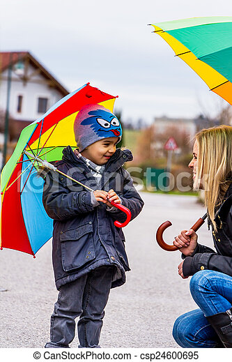 mother and child with umbrella - csp24600695