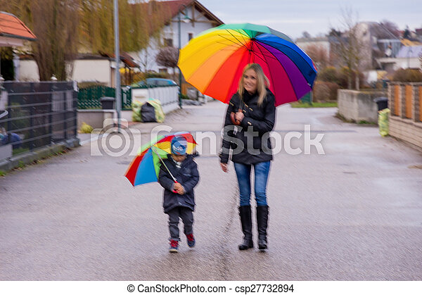 mother and child with umbrella - csp27732894